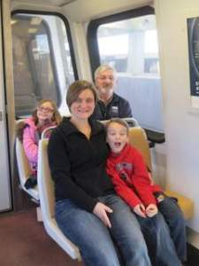 Riding the metro in DC with Grandpa and Grandma and Aunt Abby